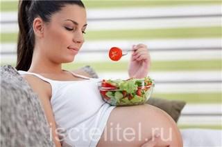 Почему болит желудок у беременной?